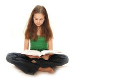The young girl the teenager reads books stock photography