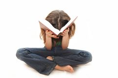 The young girl the teenager reads books Royalty Free Stock Photos