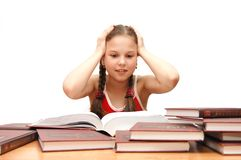 The young girl the teenager reads books Royalty Free Stock Photo