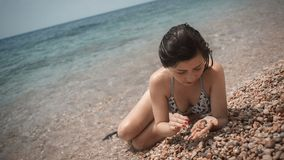 Young girl the teenager on a sea beach Royalty Free Stock Photos