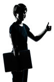 Young girl teenager silhouette holding. One caucasian young teenager silhouette boy girl holding carrying laptop computer thumb up portrait in studio cut out Royalty Free Stock Photos