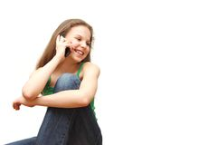 The young girl the teenager speaks on the phone Royalty Free Stock Images