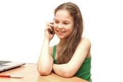 The young girl the teenager speaks on the phone royalty free stock photo
