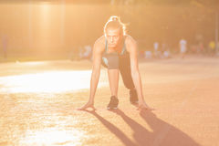 Young girl teenager sprinter start position Stock Photos