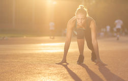 Young girl teenager sprinter start position Royalty Free Stock Photos