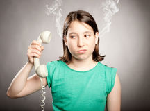 Young girl with telephone overwhelmed Royalty Free Stock Photo