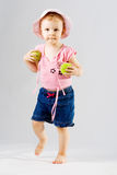 Young girl with tennis balls Stock Photo