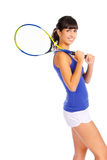 Young girl with a tennis racket. Over white background Stock Image
