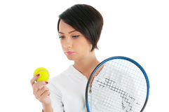 Young girl with tennis racket and bal isolated Stock Photo