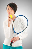 Young girl with tennis racket and bal  Stock Images