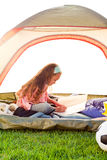 Young girl in tent Royalty Free Stock Photos
