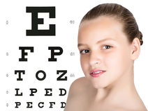 Young girl with test vision table over background. concept of preservation children`s vision Royalty Free Stock Images