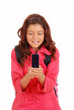 Young girl texting on cell phone. Isolated Young girl texting on cell phone Royalty Free Stock Image