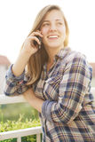 Young girl texting on the phone. Young teen laughing while talking on the phone Royalty Free Stock Photo