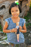 Young girl with thanaka paste on her face holding a doll, Amarap Stock Image