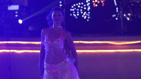 Young girl in theatrical costume with wings dances belly dance stock footage