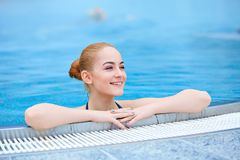 Young girl in a thermal pool. At wintertime royalty free stock image
