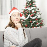Young girl think about christmas Royalty Free Stock Photography