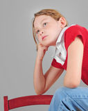 Young girl thinking Royalty Free Stock Images