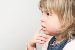 Young girl is thinking Royalty Free Stock Photography