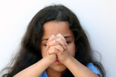 Young Girl Thinking. Young girl on white background who is thinking or praying Royalty Free Stock Photos
