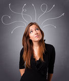Young girl thinking with arrows overhead Stock Photography
