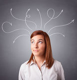 Young girl thinking with arrows overhead Stock Photos