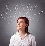 Young girl thinking with arrows overhead Stock Photo