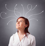 Young girl thinking with arrows overhead Royalty Free Stock Photos