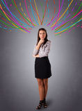 Young girl thinking with colorful abstract lines overhead Stock Photography