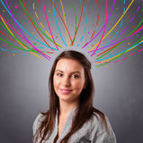 Young girl thinking with colorful abstract lines overhead Royalty Free Stock Photography