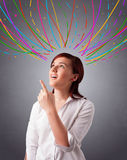 Young girl thinking with colorful abstract lines overhead Royalty Free Stock Images