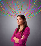 Young girl thinking with colorful abstract lines overhead Royalty Free Stock Photos