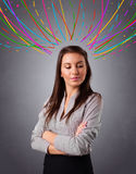 Young girl thinking with colorful abstract lines overhead Stock Photo