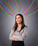 Young girl thinking with colorful abstract lines overhead Stock Photos