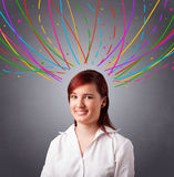 Young girl thinking with colorful abstract lines overhead Stock Images