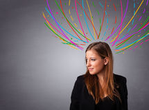 Young girl thinking with colorful abstract lines overhead Royalty Free Stock Image