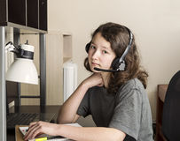 Young Girl Thinking before doing her Homework Royalty Free Stock Photos