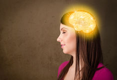 Young girl thinking with glowing brain illustration Royalty Free Stock Photography