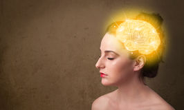 Young girl thinking with glowing brain illustration Stock Photos