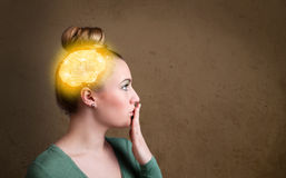 Young girl thinking with glowing brain illustration Royalty Free Stock Image