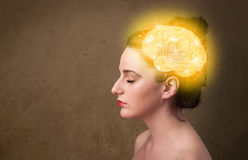 Young girl thinking with glowing brain illustration Royalty Free Stock Photos