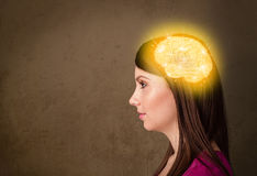 Young girl thinking with glowing brain illustration Royalty Free Stock Images