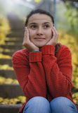 Young girl thinking at her boyfriend. Sweet expression of young woman royalty free stock photos