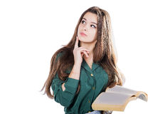 Young girl thinking, holding the book to isolate.  Royalty Free Stock Image