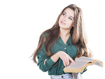 Young girl thinking, holding the book to isolate.  Stock Photos