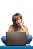 Young girl thinking with laptop Royalty Free Stock Image