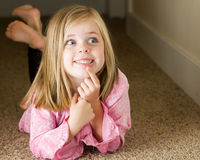 Young girl thinking Stock Images
