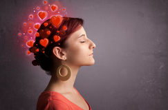 Young girl thinking about love with red hearts Stock Photo