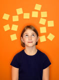 Young Girl Thinking and Sticky Notes Royalty Free Stock Photos